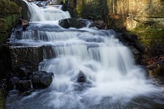 Mini Falls.... (klythawk) Tags: brown sunlight white black green nature leaves spring rocks shadows derbyshire peakdistrict olympus matlock omd em1 1240mm lumsdale klythawk