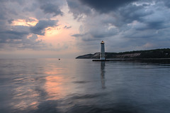 Ahead of the Weather (Aaron Springer) Tags: blue sunset storm reflection nature water landscape pier boat spring twilight outdoor michigan may lakemichigan maritime boating bluehour nautical stormclouds frankfort sportfishing stormlight northernmichigan thegreatlakes frankfortlighthouse