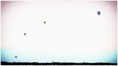 Parabolic rise (glukorizon) Tags: sky contrast horizon ballon lucht vignetting luchtballon airballoon hss colourchange vignettering kleurverandering sliderssunday 52weeksof2016