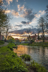 Sunset over river (Diogoku) Tags: bridge trees sunset nature clouds river reflex nikon lanscape vilnius warmcolors