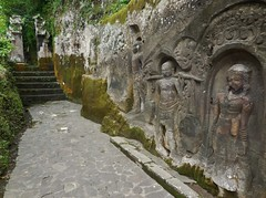 ancient Balinese rock carvings (SM Tham) Tags: bali cliff rock indonesia island temple asia path steps walkway gateway stories stonecarvings niches basreliefs yehpulu