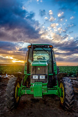 Tractor at Day's End (Rod Heywood) Tags: tractor deere farmequipment farm farms tractors agriculture agriculturalequipment croprows tractorcab salinasvalley salinas california centralcoast montereycounty sunset clouds green johndeere parkedtractor settingsun work vehicle workvehicle farmindustry crops vegetables saladbowloftheworld cauliflower lettuce tractortires tires