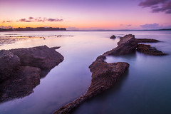 面朝大海 (nzfisher) Tags: longexposure blue sunset sea newzealand sky orange seascape beach clouds canon landscape twilight rocks sundown dusk auckland northshore bluehour 24mm northhead