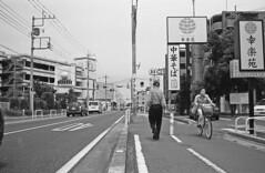 Untitiled (odeleapple) Tags: bw classic film bike 35mm voigtlander bessa pedestrian sidewalk nokton redfilter r2m neopan100acros mcr2
