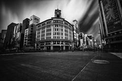 Ginza ([~Bryan~]) Tags: road city blackandwhite building clock japan architecture tokyo ginza traffic urbanlandscape cloudmovement daytimelongexposure