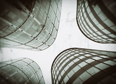Cell Division - London City Office Life by Simon & His Camera (Simon & His Camera) Tags: city urban blackandwhite bw building london tower window glass monochrome lines vertical skyline architecture office distorted outdoor vertigo lookingup wetplate curve vignette simonandhiscamera