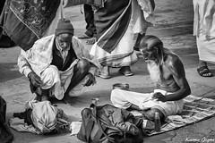 A world apart (karmajigme) Tags: travel blackandwhite india men monochrome nikon asia noiretblanc streetphotography human varanasi sadhu pilgrims