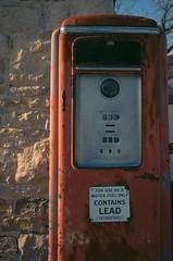 Contains Lead (torn8o) Tags: vintage kansas fujivelvia50 antiquegaspump canoneos3 strongcity canon1740mml tallgrassprairienationalpreserve