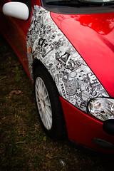 Opel Tigra Stickerbomb (Matteo Scardino) Tags: auto car canon sticker automotive macchina opel treviglio tigra rossa opeltreffen 18135 redrosso 70d stickerbomb opeltigra canon70d radunoopel