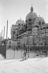 Marseille, cathdrale de la Major (Jemira Photo) Tags: street bw playing film kids analog major blackwhite marseille cathedral scooter d76 agfa selfdeveloped apx400 leicamp 35summicronasph