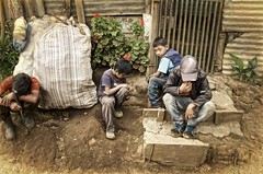the bored brothers (Pejasar) Tags: boy boys frontporch street candid rural guatemala nearantigua machete bags foliage house years others