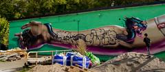Dragon graffiti streetart (fredrik.gattan) Tags: graffiti streetart art colorful arm hand dragon tattoo boy wall decay concrete industrial area large autumn snstragrnd snstra stockholm sweden artist