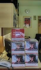 """Prompters` & Stage Callers` Office: Donation Boxes """"Aid to Refugees. Austrian Red Cross"""" for collecting after performances Dienstzimmer Inspizienten Souffleusen: Spendenboxen Flchtlingshilfe sterreichisches Rotes Kreuz fr Sammlungen nach Vorstellungen (hedbavny) Tags: asylant flchtling asylwerber refugee dienstzimmer inspizienten sammlung sammeln collecting donation donationbox box cube wrfel flchtlingshilfe roteskreuz redcross plakat jugendstil artdeco artnouveau uhr watch clock probe rehearsal work arbeit theater theatre boy bub junge portrait portrt lautsprecher inventar inventarnummer liste schild workingroom arbeitsraum tr door open offen spiegel mirror spiegelung reflection nachtarbeit auto car mercedes weis white blue blau schwarz black frau woman stage backstage schreibtisch tisch table wien vienna austria sterreich hedbavny"""