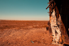 Last chance to sea - Aral Sea // Kazakhstan (Demipoulpe) Tags: trip sea color water graveyard canon sadness harbor sand asia ship central salt rusty disaster seashell 24mm kazakhstan madmax aral ecolog