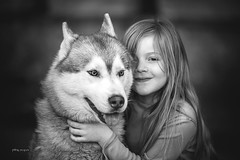 The girl and the wolf... (danielpi39) Tags: portrait dog girl animal canon children blackwhite wolf noiretblanc retrato candid naturallight blackdiamond