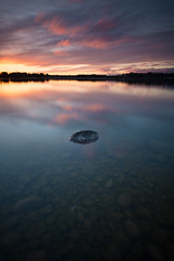 Shallow water and small rock (- David Olsson -) Tags: longexposure sunset lake seascape nature water clouds landscape evening nikon rocks colorful sundown cloudy sweden outdoor stones vivid le april late shallow colourful fx grad vr grunt vänern d800 hammarö 1635 2016 ndfilter blackglass 1635mm lakescape gnd skoghall leefilters lenr bigstopper mörudden davidolsson 06hard 1635vr smothwater