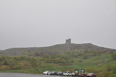 Cabot Tower on Signal Hill- visible from our hotel window (oldandsolo) Tags: canada nfl stjohns signalhill badweather coastaltown cabottower localhistory heavyrain lookoutpoint communicationscentre easterncanada newfoundlandandlabrador downtownstjohns