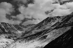 Scattered Snowfall pt. 2 (Shakti Priyan Nair) Tags: trip blackandwhite white mountain snow black mountains monochrome landscape cloudy outdoor pass snowcapped leh ladakh khardungla highest clouded motorable
