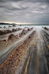 Les rails. (Herv D.) Tags: rails lines ocean mer sea atlantic atlantique basque cte shore sakoneta rocks rochers landscape seascape