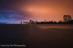 Here comes the Rain again. (Lens Cap Tim Photography) Tags: blue orange lake chicago storm rain evening nikon shore lakeshore d750 tamron35mm