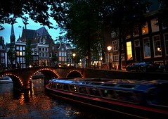 Canal Boat (Clare-White) Tags: canal boat motion water bridge amsterdam july night buildings lights