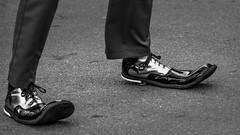 Toey (GreyStump) Tags: street urban blackandwhite bw blancoynegro feet blackwhite shoes noiretblanc clown australia pb sp canberra streettheatre nationalfolkfestival toey streetact greystump copyrightcolinpilliner