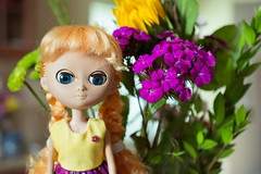 Dobinnips poses with flowers (janetsaw) Tags: pink orange flower green yellow japan doll una collectible duna moof unaweek