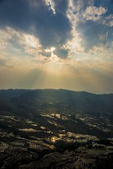 Bada (gerd benninger) Tags: china travel sky cloud sun mountains reflection water clouds zeiss landscape terrace sony terraces carl yunnan sunrays riceterraces bada a99 sonya99 auanyang