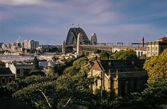 000019 (jayolz) Tags: city film skyline 35mm sydney olympus sydneyharbourbridge fujisuperia fujisuperiaxtra400 olympus35sp 35sp