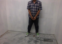 Prisoner chained to floor (asiancuffs) Tags: prison shackles handcuffs arrested arrest prisoner shackled handcuffed