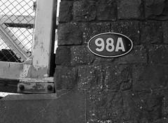 98A (Man with Red Eyes) Tags: bridge monochrome sign zeiss canal blackwhite conversion lancashire 98 number m8 lancaster lenstest lancastercanal 98a leicam8 incamerajpeg distagont1435zm