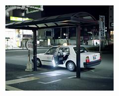 Taxi, Japan. (Komkrit.) Tags: city urban art film japan analog work ride pentax kodak taxi photograph hour service after 6x7 job 67 hospitality soon 160 allrigthsreserved thusanapanont komkrit mamonaku   komkritthusanapanont