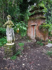 a forgotten garden (SM Tham) Tags: trees bali plants overgrown statue indonesia outdoors island ruins asia doorway watergardens jungle gateway portal clearing pedestal waterpalace karangasem tirtagangga amlapura gardenstosee
