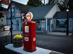 Jenney Aero (trochford) Tags: old flowers red usa building clock canon vintage eos lights evening twilight colorful exterior outdoor dusk garage newengland newhampshire nh illuminated gas pump petrol gasoline bennett gaspump aero autoservice petrolpump jenney amherstnh mikesautoservice jenneyaero