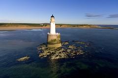 Sunrise over Rattray Head lighthouse (iancowe) Tags: morning summer lighthouse beach rock sunrise dawn scotland aberdeenshire head scottish aerial stevenson drone peterhead northernlighthouseboard rattray nlb rattrayheadlighthouse