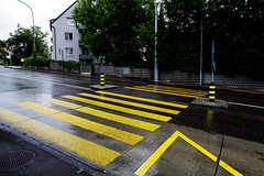 Yellow Crossing (harragan) Tags: road color colour wet rain yellow canon eos switzerland crossing zurich zebra 5d mkii