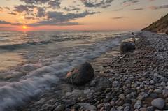 Wild Nights (Aaron Springer) Tags: sunset summer nature water rock stone landscape surf outdoor michigan dune shoreline lakemichigan lakeshore serene northernmichigan sleepingbeardunesnationallakeshore thegreatlakes