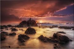 Despues llego la tormenta. (Caramad) Tags: mar landscape sunset meakoz olas puestadesol rocas agua longexposure marina light wate wave rocks seascape marcantbrico sea espaa playa