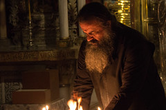 Preparing the Candles, Greek Orthodox Priest at the Church of the Holy Sepulchre (marylea) Tags: history israel site ancient jerusalem christian altar holy historical priest churchoftheholysepulchre crucifixion greekorthodox 2015 may11