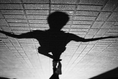 266/365 Open Arms (ewitsoe) Tags: street morning light shadow urban man adam 35mm spring mood cityscape sidewalk 365 lightandshadow poznan urbanite openarms nikond80 pasaz ewitsoe