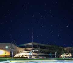 Night Sky Above School (Amazing Backgrounds) Tags: from above school trees sky usa cold tree cars glass beautiful night america photoshop stars concrete lights illinois high bush nikon doors view unitedstates bright space flag parking bracket lot pole iso explore galaxy american astrophotography views noise hdr lightpollution viral bracketing d90 1million