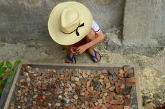 133/366 (moke076) Tags: travel light boy vacation oneaday hat project mexico outside kid nikon friend cowboy natural maya mayan photoaday flipflops vista pottery 365 alegre drying quintanaroo sherds 2016 366 archeaology project365 chiquila jipijapa 365project project366 d7000