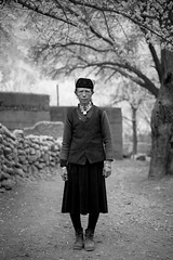 Women in village (Keith211) Tags: china leica travel trees bw woman tree kids photography mono blackwhite kid village apricot xinjiang persons bwphotography bwphoto pepole blackwhitephoto outdoorphotograph leicam outdoorphotographer thepamirsmountain