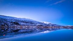 Frozen Blue (Skyholique) Tags: blue sunset mountain snow ice norway landscape twilight outdoor hour fjord scandinavia tromso troms mountainscape trom