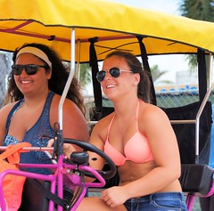 Beach Buggy Cuties (Andy Arecco) Tags: ladies vacation two cute beach beautiful up closeup happy big sitting close view steering florida top south young smiles front riding bikini hollywood boardwalk denim shorts buggy cuties
