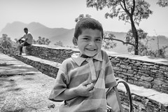 delighted (Joshi Anand) Tags: nepal boy bw india trek happy nikon raw nef d750 handheld nikkor pokhara pune vr joshi anand 1635 annapurnabasecamp anandjoshi