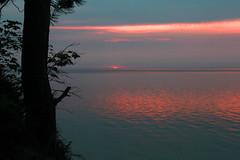 Splashdown (RPahre) Tags: sunset sun lake tree silhouette michigan greatlakes upperpeninsula lakesuperior picturedrocks picturedrocksnationallakeshore