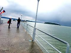 Lago Trasimeno (Elena Scortecci) Tags: people italy lake water rain lago italia persone boardwalk acqua pioggia umbria trasimeno passerella
