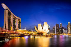 Singapore (Patrick Foto ;)) Tags: park city travel bridge blue light sea sky urban panorama reflection building tower tourism water beautiful skyline architecture modern night skyscraper marina river landscape asian outdoors hotel evening bay twilight singapore asia downtown cityscape waterfront district famous landmark scene tourist casino structure illuminated business helix sands sg