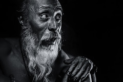 Bug-eyed (Axel Halbgebauer) Tags: street old nepal portrait people blackandwhite bw black face closeup blackbackground 35mm dark beard blackwhite eyes hands candid streetphotography oldman kathmandu oldage southasia saarc sonyalpha streetportait sonyimages distagon3514za sonya7r2